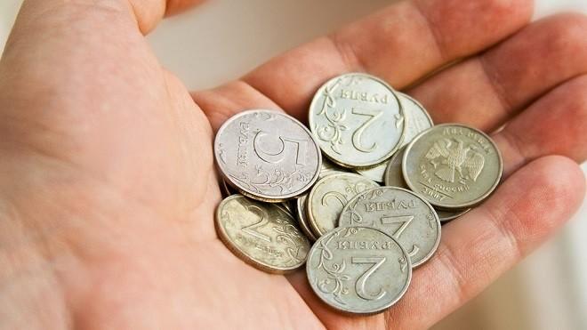 Горсть монет в ладони